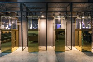 Golden jewelry display stands at Chaumet event by Loesje Kessels Fashion Photographer Dubai