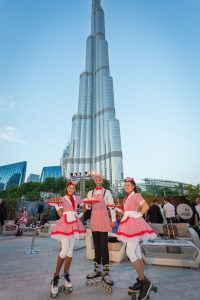 Servers on roller-skates at the Dubai Opera House event by Loesje Kessels Fashion Photographer