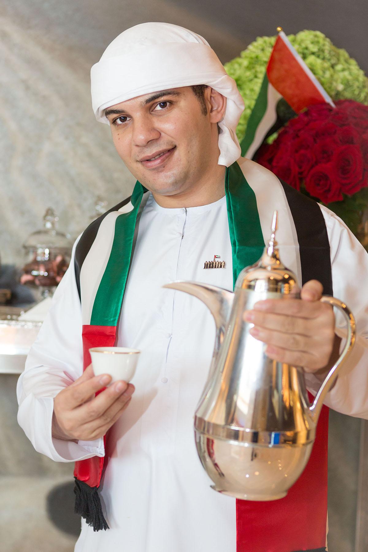 Coffee boy at Emaar's Address Boulevard by Loesje Kessels Fashion Photographer Dubai