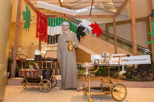 Coffee boy at Emaar's Address Dubai Mall by Loesje Kessels Fashion Photographer