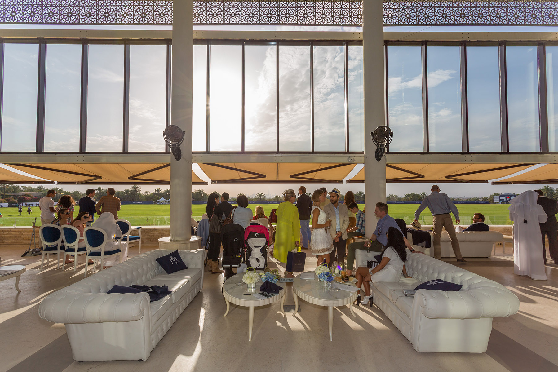 Guests watching the game at the Maserati Polo event by Loesje Kessels Fashion Photographer Dubai