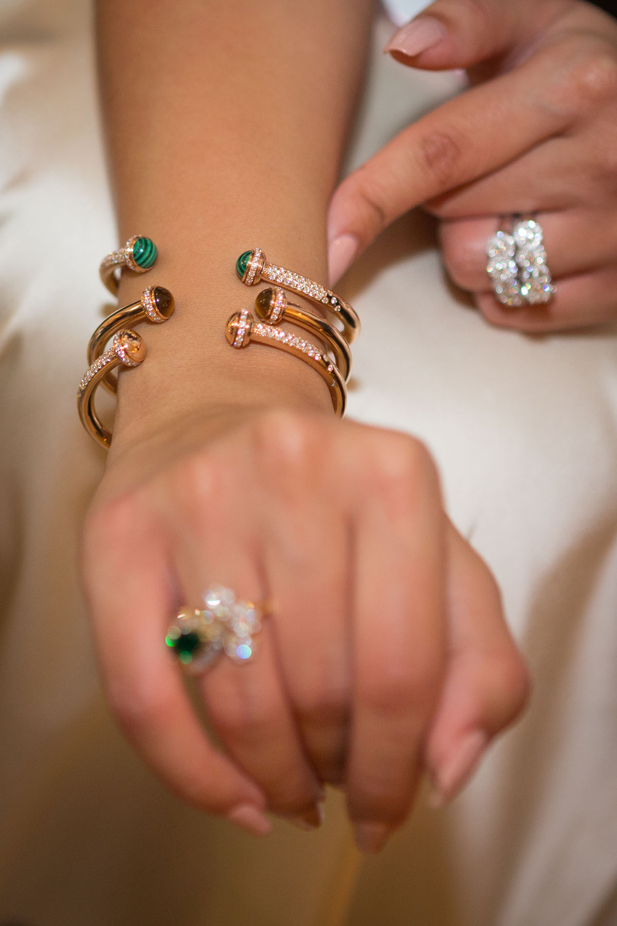 Guest trying on 3 new bracelets at the Piaget event by Loesje Kessels Fashion Photographer Dubai