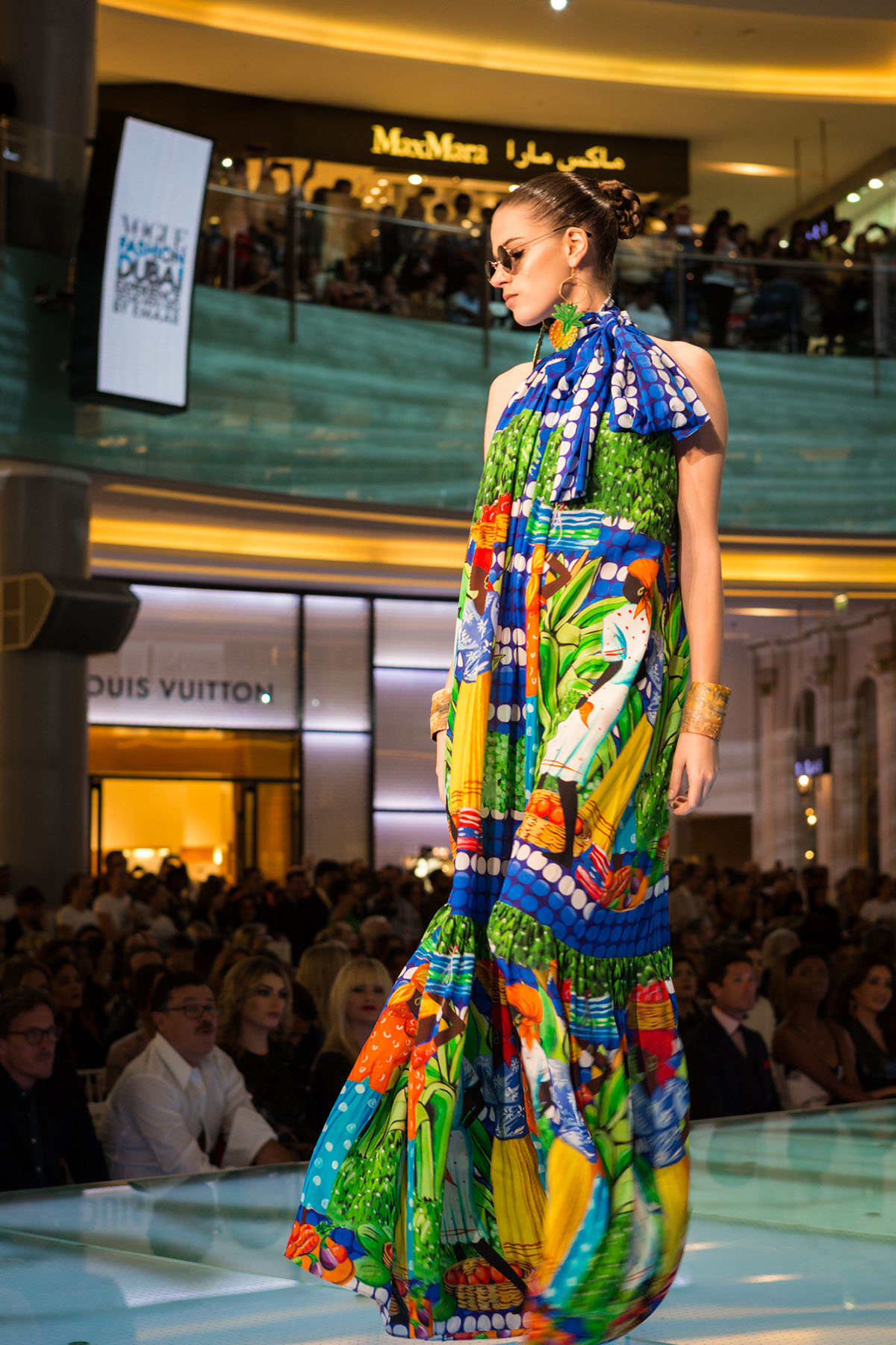 Model walking the runway at the Vogue Fashion Show event in Dubai Mall by Loesje Kessels Fashion Photographer Dubai