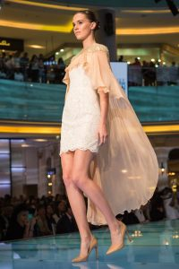 Model walking the runway at the Vogue Fashion Show event by Loesje Kessels Fashion Photographer Dubai