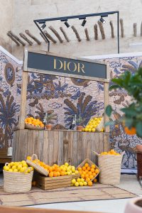 Lemon and orange stand at DIOR Cruise 2020 collection presentation by Loesje Kessels Event Photographer Dubai
